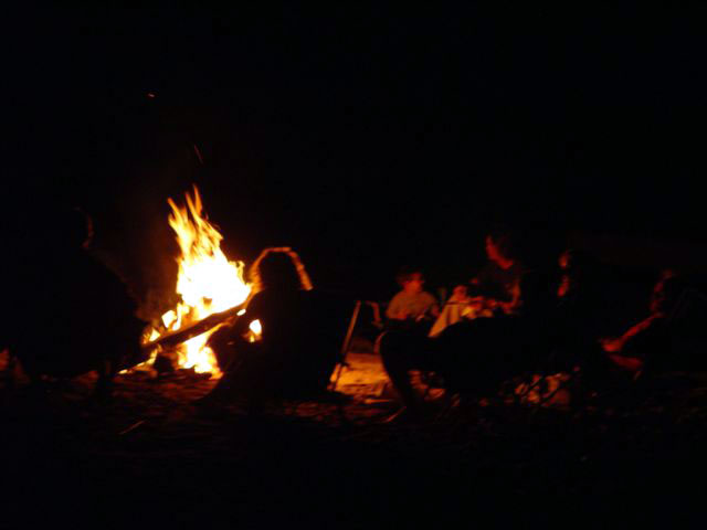 Beach fire gathering in front of the property