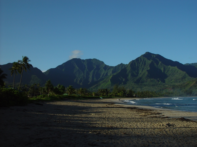 The crescent shaped beach of Hanalei Bay is nearly two miles long