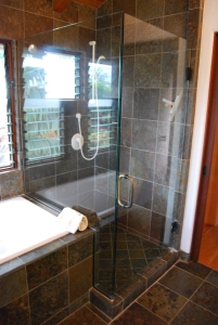 A glass enclosed walk in shower in the master bathroom